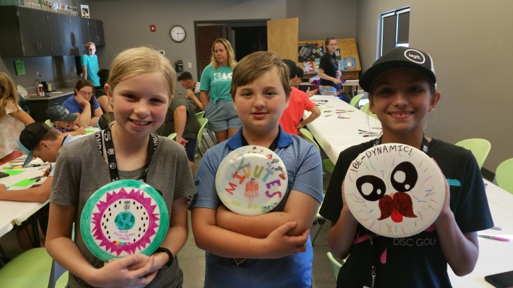 Evelyn and her friends with their decorated discs