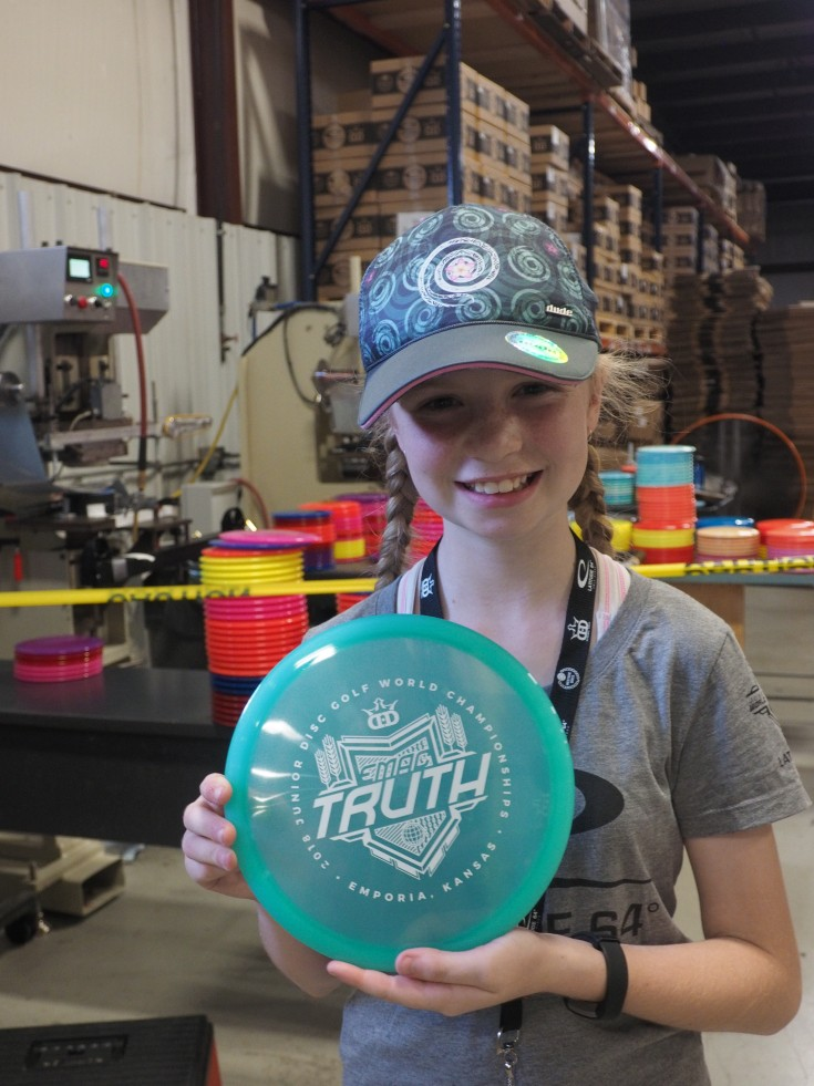 Evelyn with the disc she stamped herself