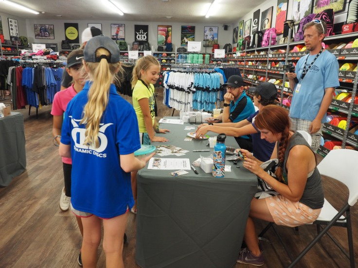 Disc and collector card signing time at Dynamic Discs, Emporia