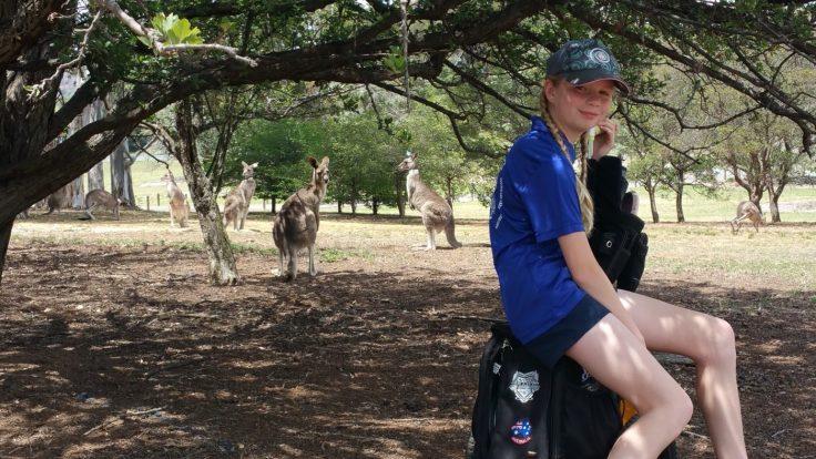 Evelyn on hole 13 with kangaroo spectators.